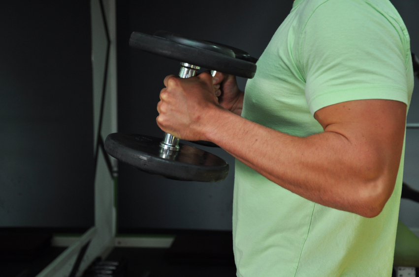 A man doing hammer curls with dumbbells