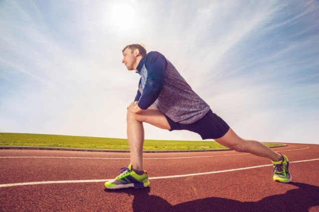 Man performing stretch on track