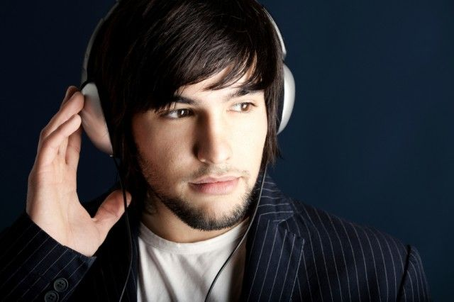 A man listens to music on his headphones