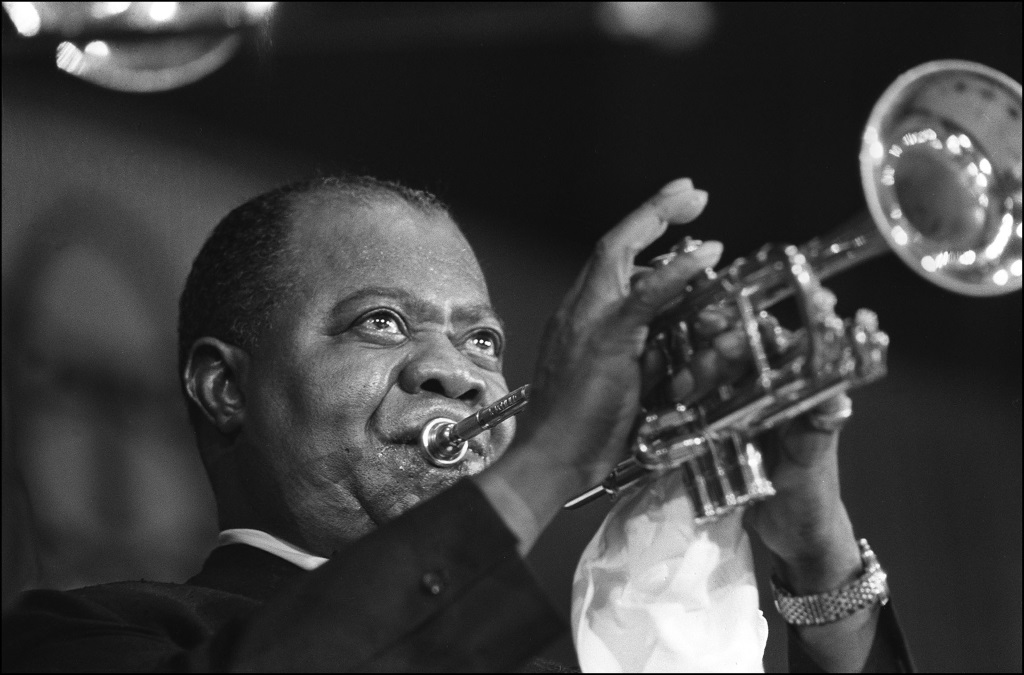 Louis Armstrong is playing the trumpet.