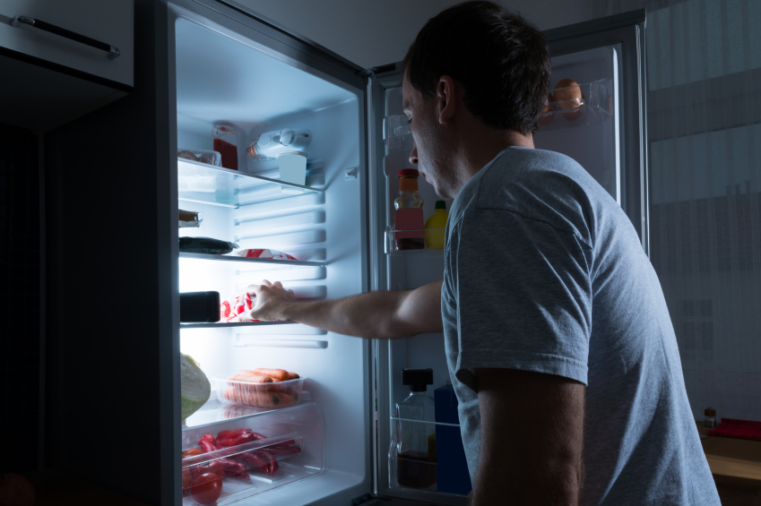 Man going for a late-night snack | iStock.com
