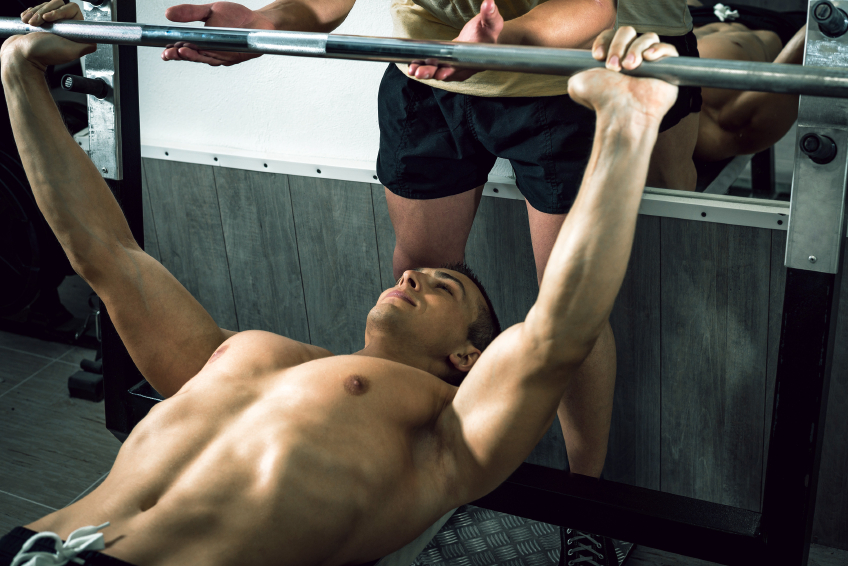 Man lifting weights with a friend