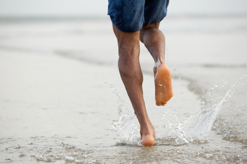 Man running barefoot