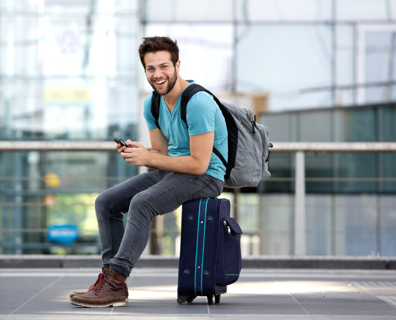 man with carry-on suitcase and backpack