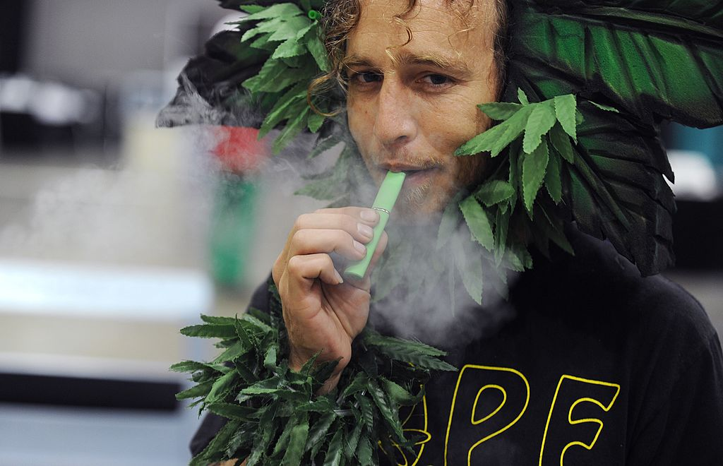 man using marijuana vaporizer