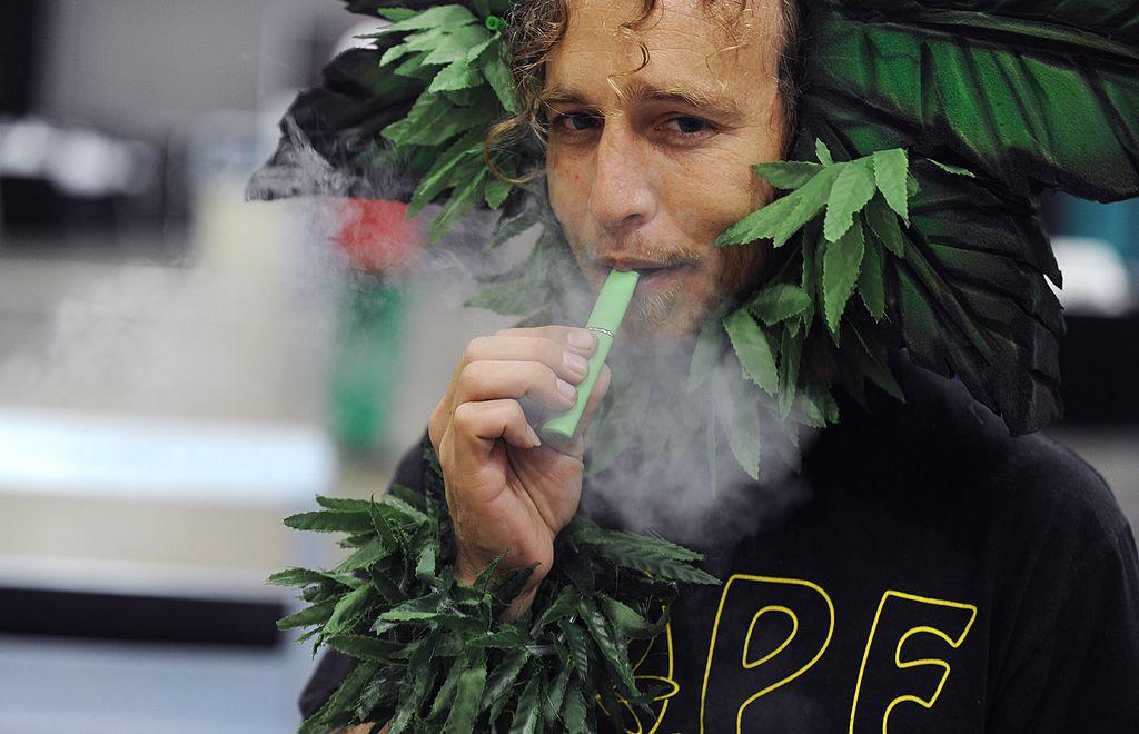 man using marijuana vaporizer