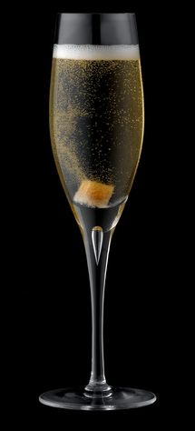 Glass of champagne and brandy, with sugar cube, close-up