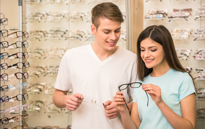couple trying out pairs of glasses