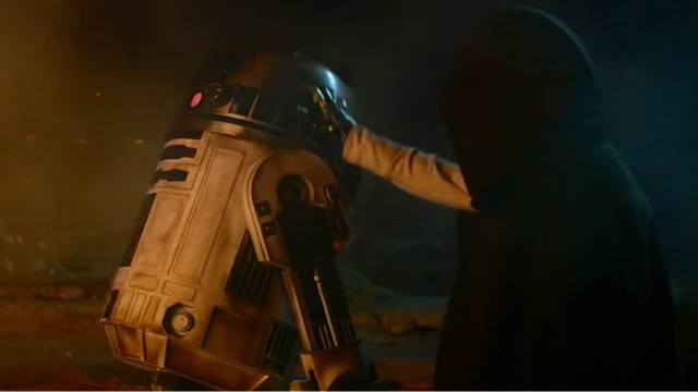 R2-D2 and a masked figure in 'Star Wars: The Force Awakens'