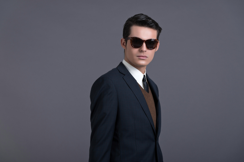 a stylish man wearing a suit and glasses