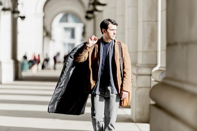 stylish man carrying a suit
