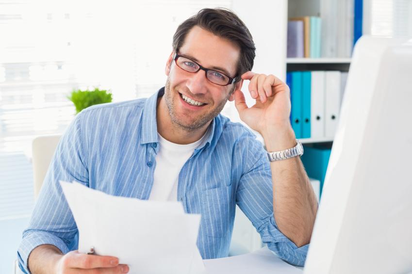 man in an office, wearing glasses