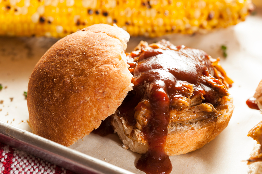 barbecue pulled pork sandwich, corn on the cob