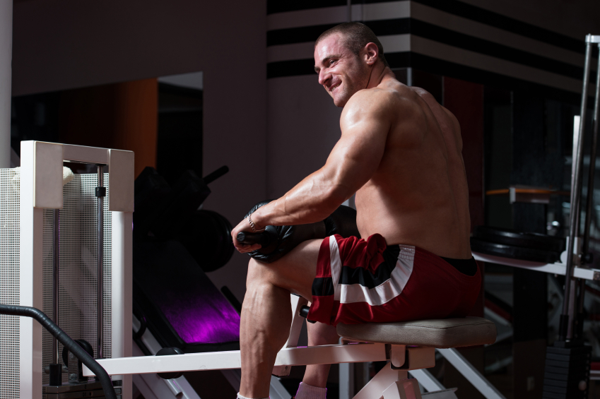 Man performing a seated calf press