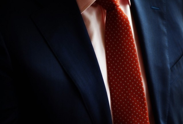 Traditional suit with red tie