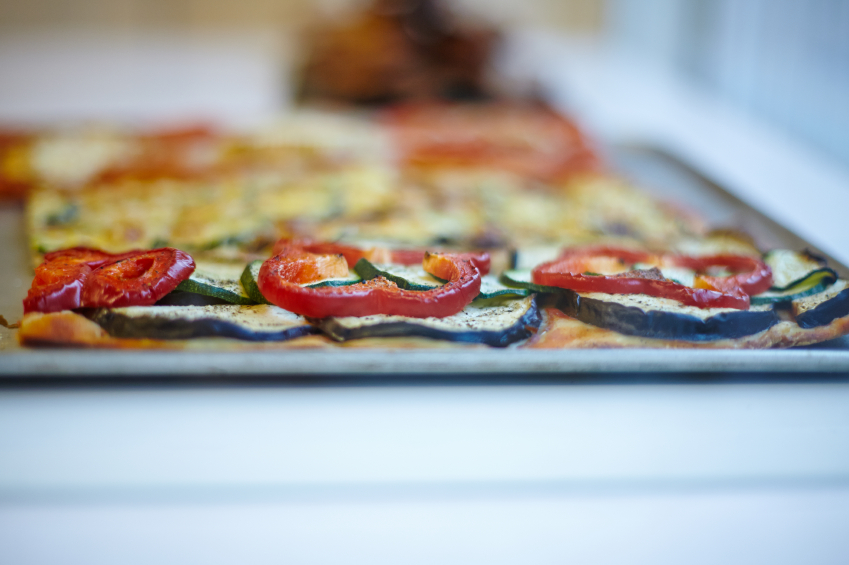 pizza with tomatoes and zucchini