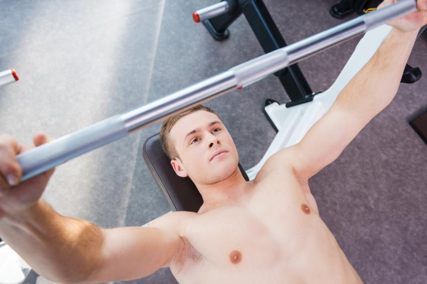 Man performing a bench press at the gym