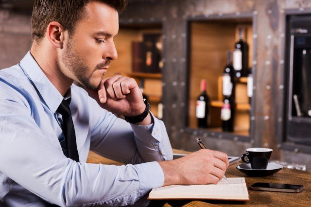 man sitting by himself at restaurant