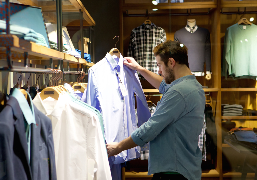 man shopping for clothes in a store