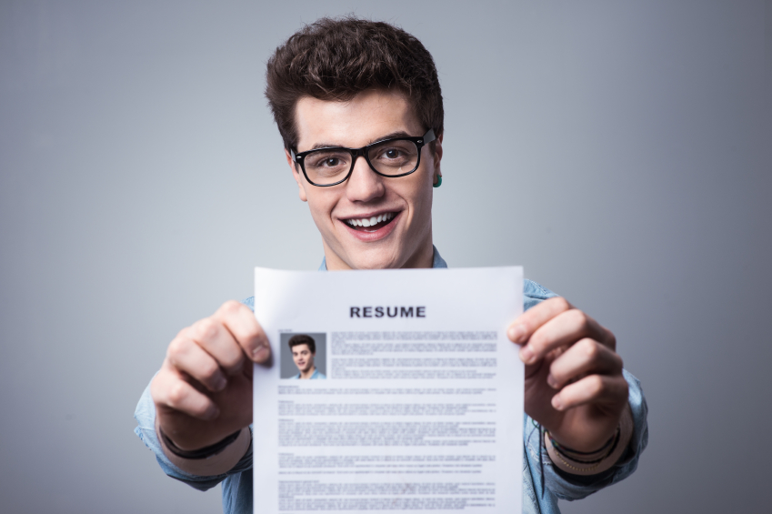 man holding up his resume