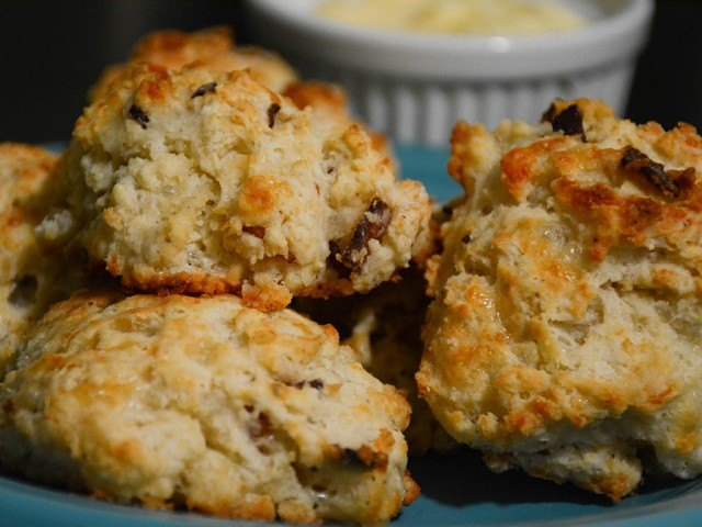 Golden bacon cheddar biscuits with honey butter