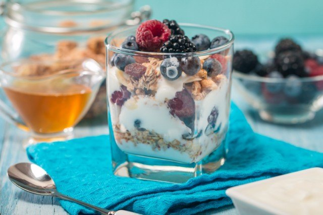 a parfait with berries and yogurt