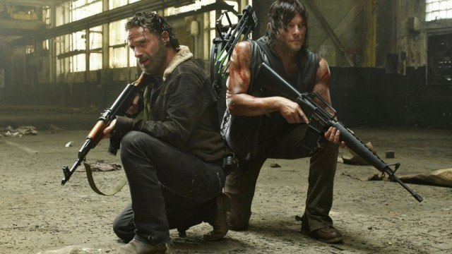 Daryl and Rick crouch holding guns