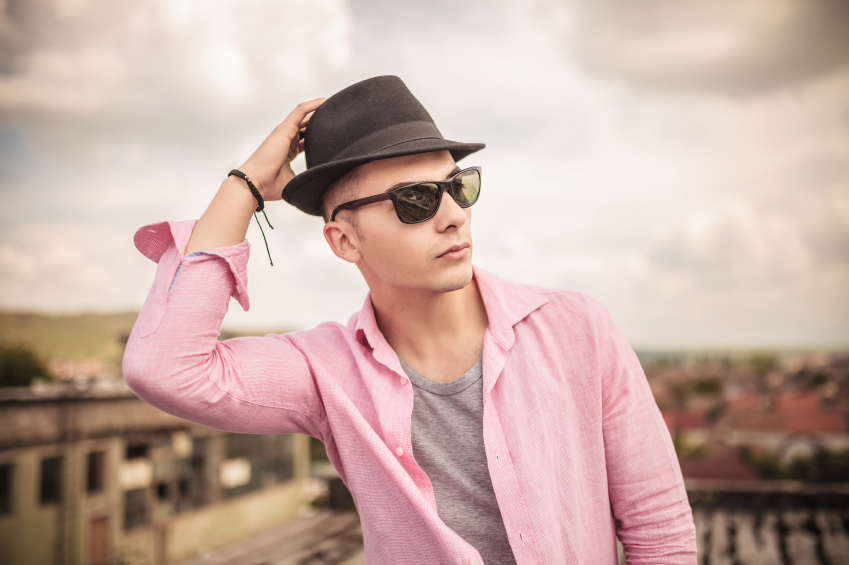 a man wearing a hat and sunglasses