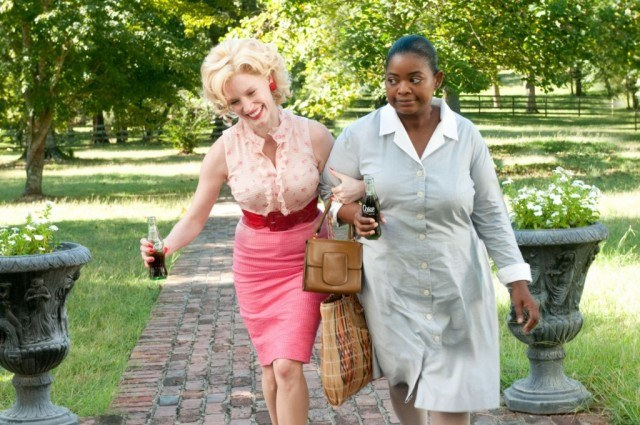 Jessica Chastain and Octavia Spencer walk arm in arm in 'The Help.'