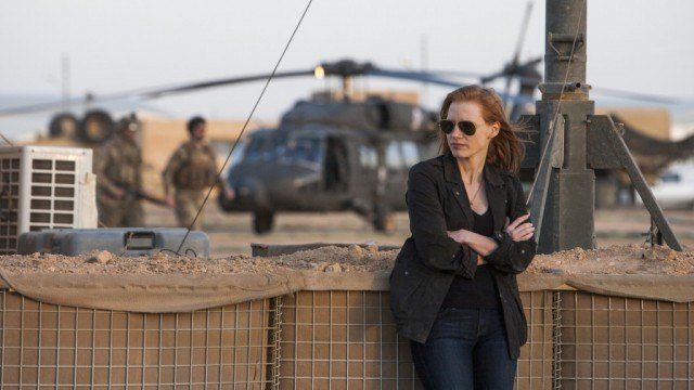Jessica Chastain folds her arms and leans against a wall in 'Zero Dark Thirty.'