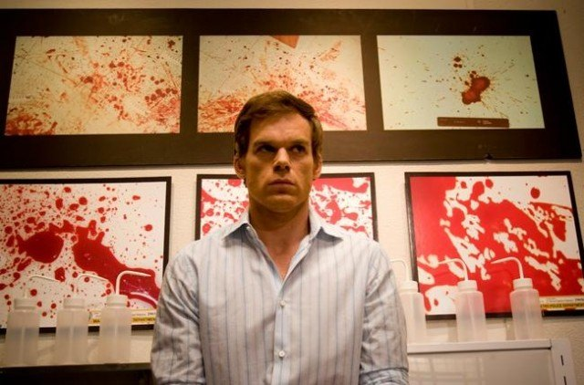 Dexter sits in front of blood splatter images