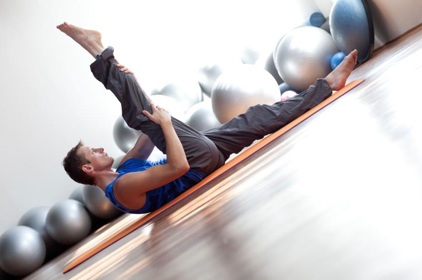 A man stretches post workout
