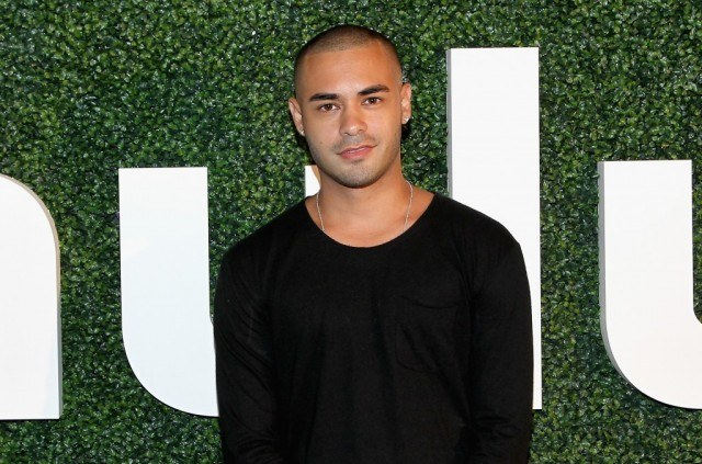 Gabriel Chavarria poses on a red carpet