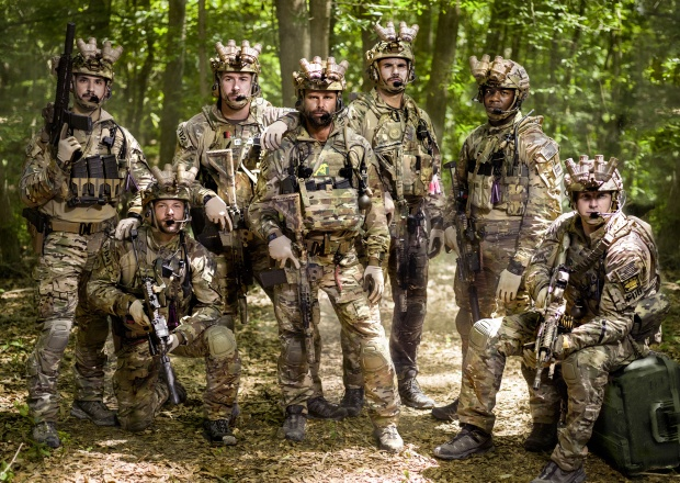 A group of soldier pose in the woods in History's Six