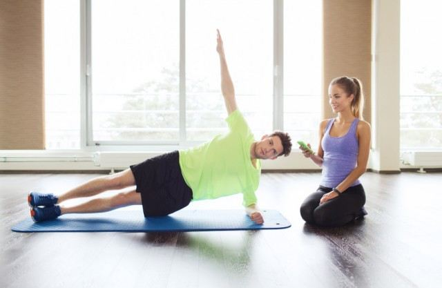man exercising next to woman