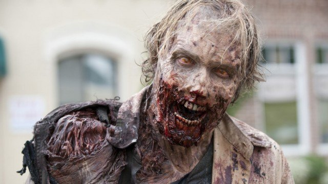 A disfigured zombie on The Walking Dead