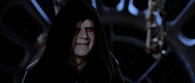 Emperor Palpatine smiling while in a dark robe.
