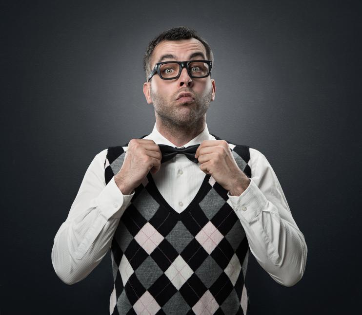 man wearing a sweater vest