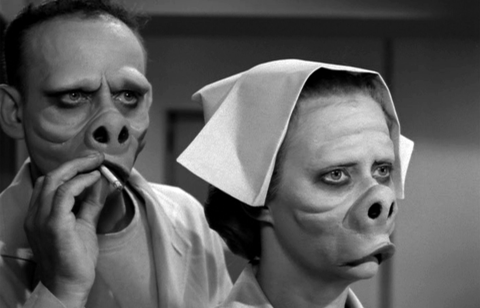 A man and a woman with pig snouts on The Twilight Zone