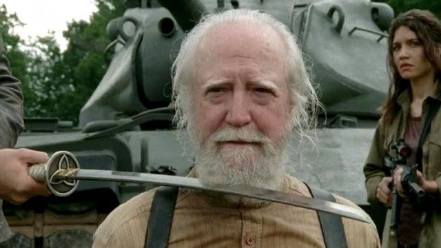 "Hershel (Scott Wilson) sits with a katana to his throat in a scene from 'The Walking Dead' episode ""Too Far Gone"""