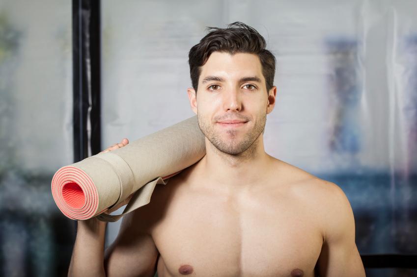a man holding a yoga mat