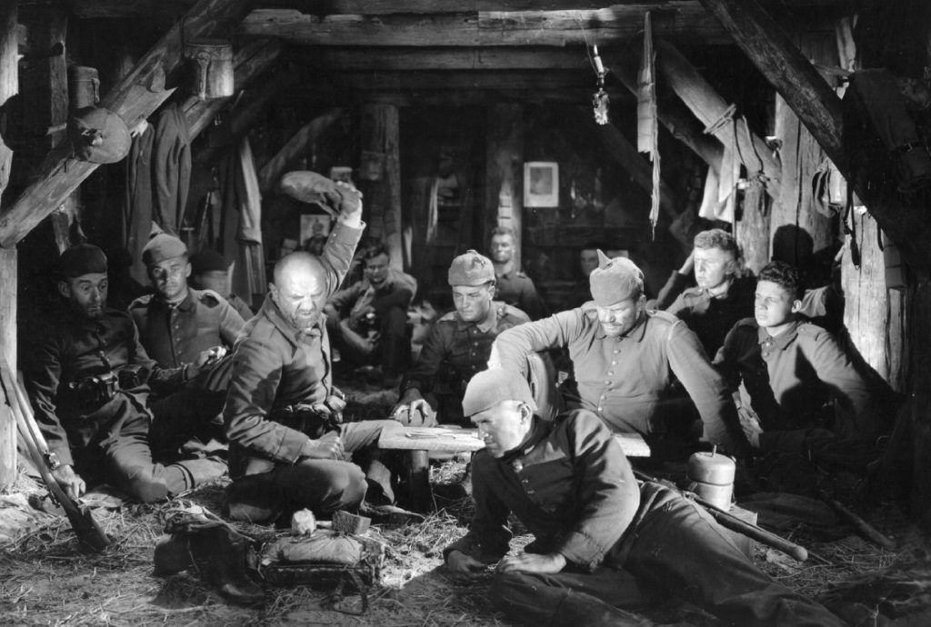 A group of soldiers sit together in what appears to be a mine-shaft