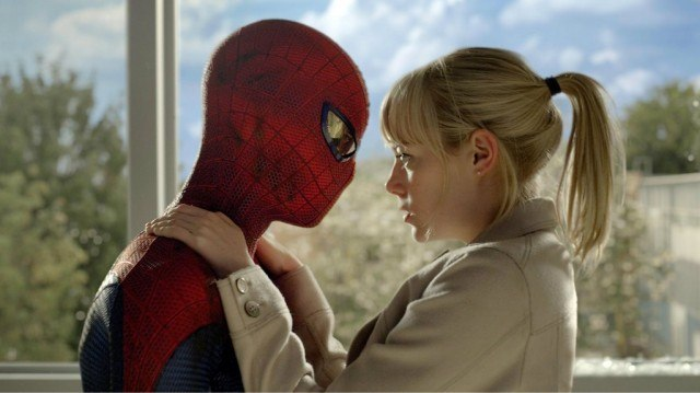 Spiderman appears emotionless as he embraces Gwen Stacy