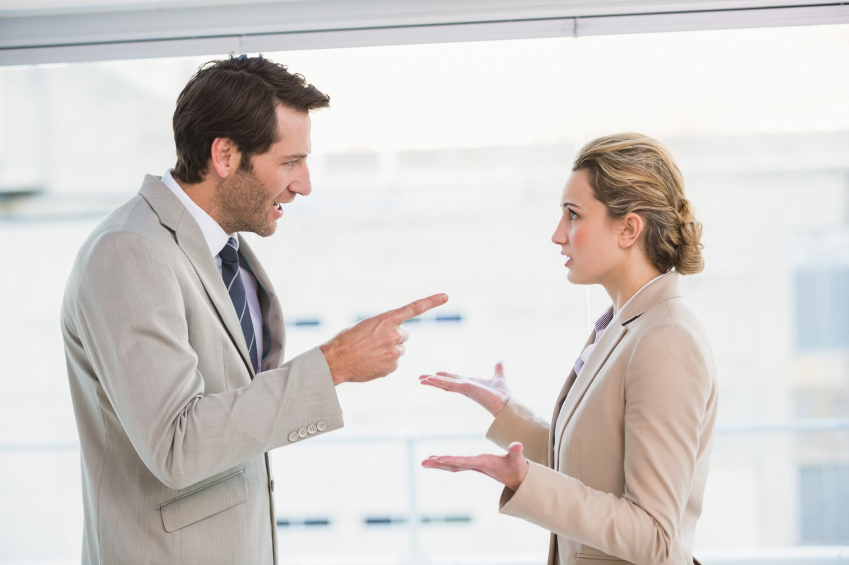 A woman has a conversation with her angry boss