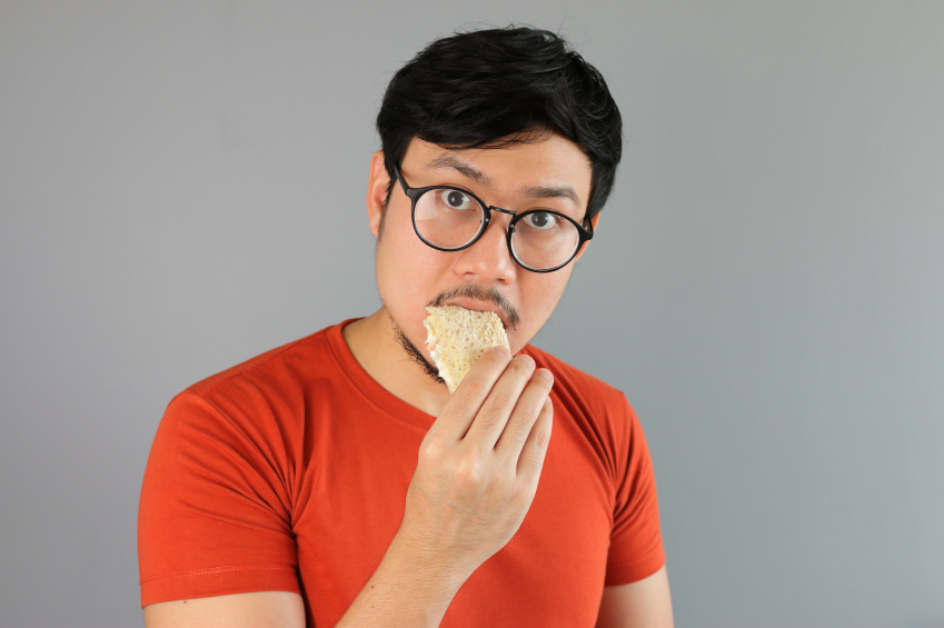 a man eating a sandwich