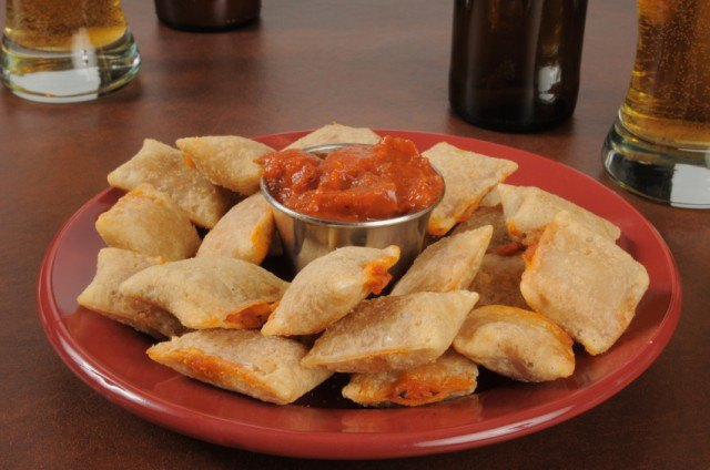pizza rolls on a dish with sauce
