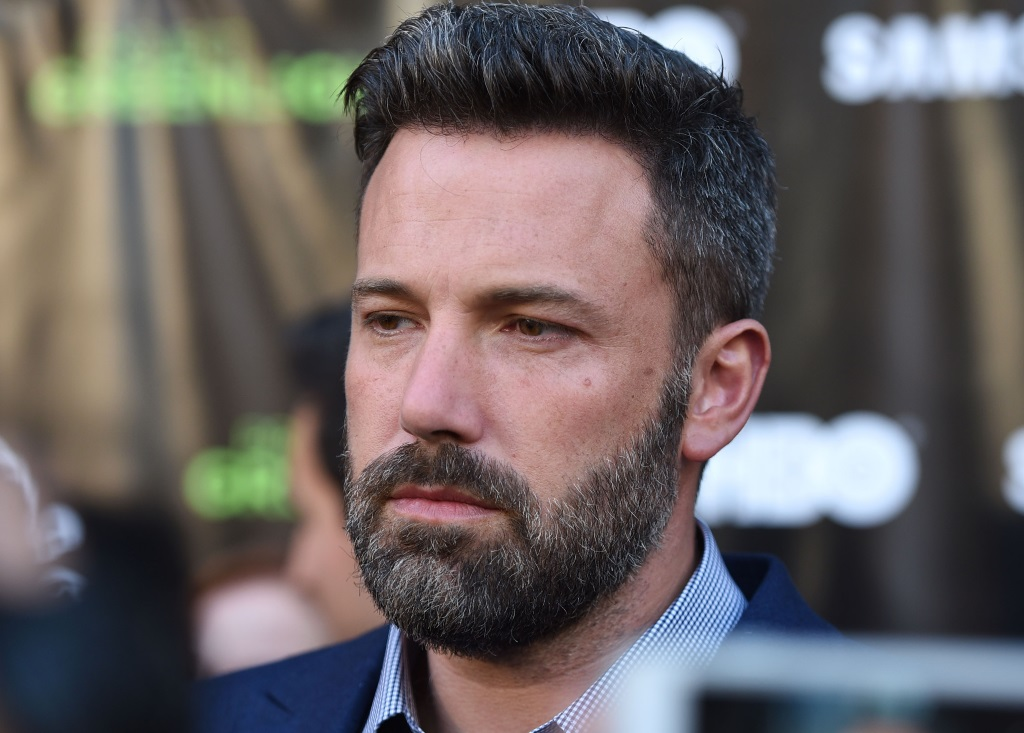 Ben Affleck is in a blue shirt and jacket on the red carpet.
