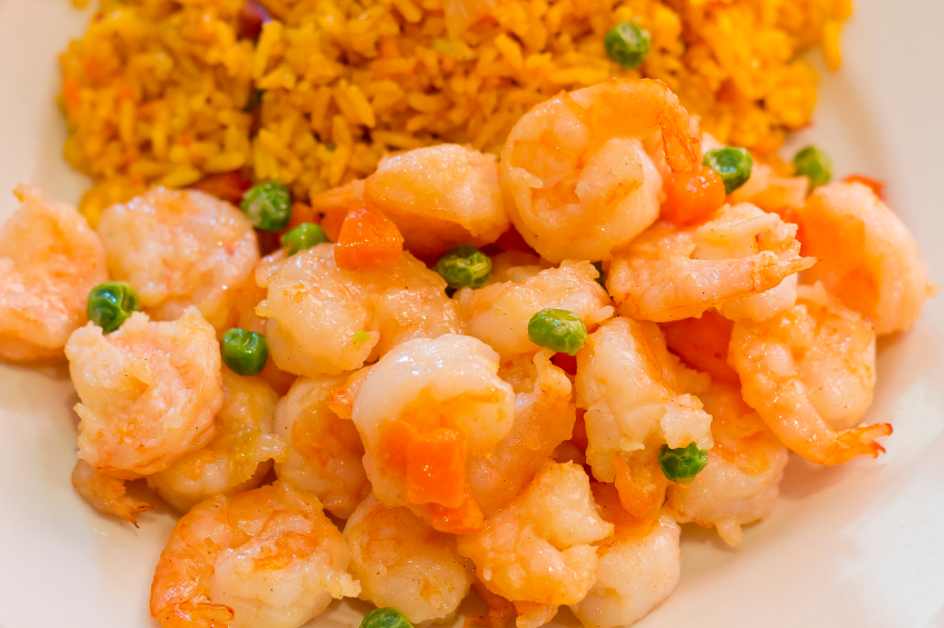 shrimp and pea stir-fry on top of rice
