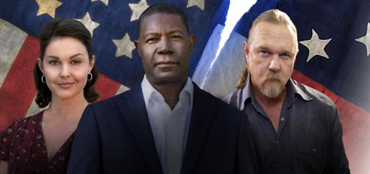 Ashley Judd, Trace Adkins, and Dennis Haysbert stare at the camera in front of a ripped American flag