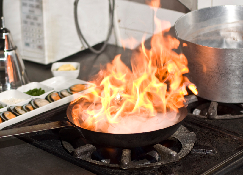 flames over a pan